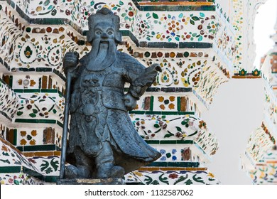 Statue in the Wat Arun temple or the Temple of Dawn,  Bangkok, Thailand