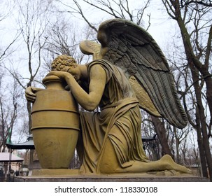 Statue of weeping angel, necropolis of Donskoy monastery, Moscow, Russia