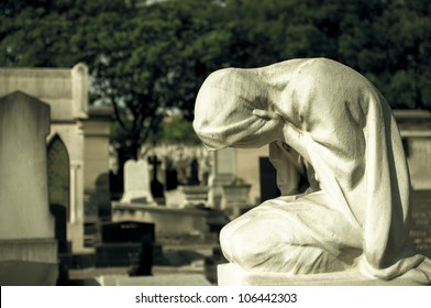 Statue of weeping woman on a grave