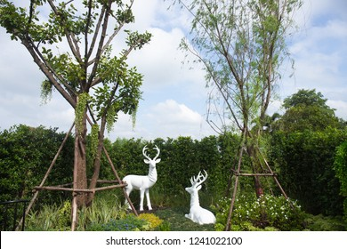 Statue of white deer in the garden in Bangkok