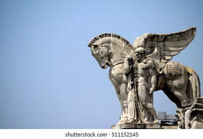 Statue of winged horse on the top of Central railway station in Milan.