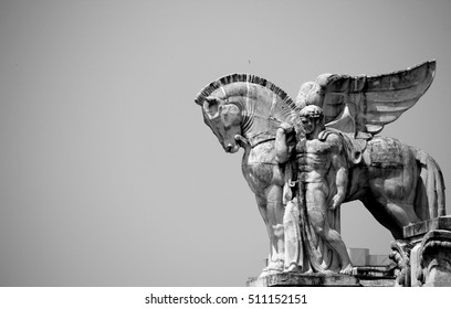 Statue of winged horse on the top of Central railway station in Milan. Black & white adjustment.