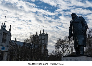 Statue of Winston Churchill with Westminster Abbey in the background in London, England