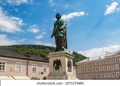 The statue of  Wolfgang Amadeus Mozart in Salzburg in a beautiful summer day, Austria