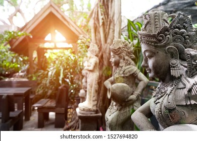 Statue of woman in literature of Bali.Indonesian-style,Fairy statues in the garden with pavilion and sunlight background in the park.