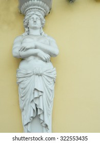 Statue of woman on wall in Targu Mures, Romania.