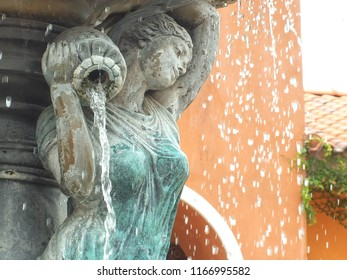 Statue of woman pouring water