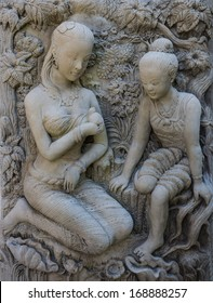 Statue of a woman. Thai ancient stone carving