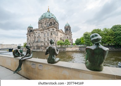 Statues along the Spree river bank opposite the Berlin Cathedral