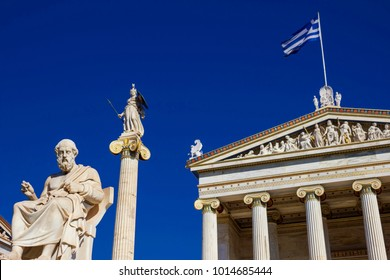 The statues of the ancient Greek philosopher Plato and the ancient Greek Goddess Athena in front of the Academy of Athens in Athens, Greece.