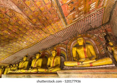Statues of Buddha in the ancient Dambulla Cave Temple in Sri Lanka.