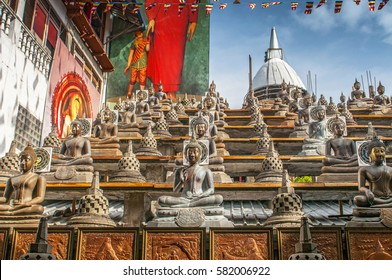 Statues of the Buddha in the lotus position, Gangaramaya Buddhist Temple, Colombo, Sri Lanka.