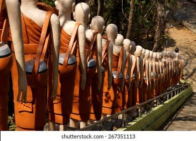 Statues of Buddhist nuns line the stairway at  Sambuk Mountain Monastery,  Kratie, Cambodia