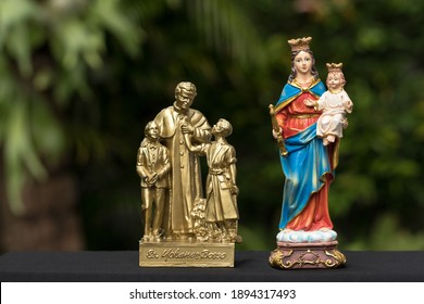 The statues of Don Bosco and Mary Help of Christians.