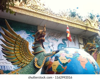 statues of the dragon with wings standing on earth in the garden of Dhammikarama Burmese Temple, Penang, Malaysia