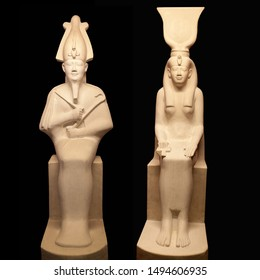 Statues of Egyptian gods Osiris and Isis on black backgroung. Osiris is lord of the death and resurrection. Isis was a major goddess in ancient Egyptian religion, the sister and wife of Osiris.