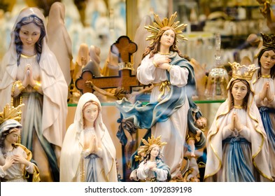 statues or figurines in a shop, the commercial side of Lourdes.