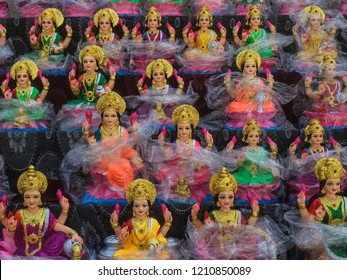Statues of godess Lakshmi displayed for sale during festival of Diwali. Handcrafted Laxmi idols for Diwali celebration are ready to sell.