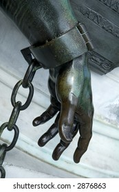 A statues hand in chains, background concept