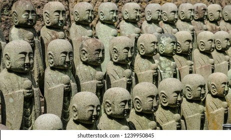 Statues of Japanese monks Jizo on the way to the Buddhist temple of Kamakura