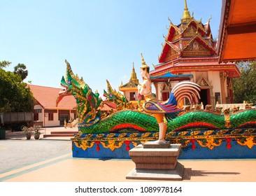 Statues of kinnaris and snakes-nagas Pavilion in Pulau Tikus, thai Buddhist temple (Wat Chayamangkalaram), famous tourist attraction in Georgetown, Penang island, Malaysia