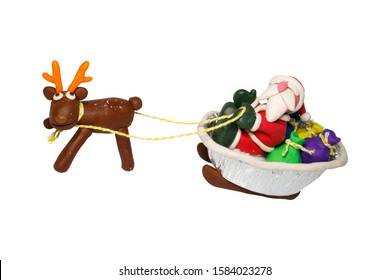 Statues like cute Santa Claus, Reindeer for children. Molding from plasticine. Cartoon character for Christmas season on white background with clipping path.