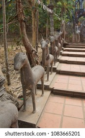 Statues line the stairway to the Buddhist temple at  Phnom Kulen, Cambodia