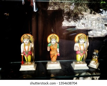 Statues of Lord Rama with his brother and his wife Sita. Colourful statues of Lord Ganesh with yellow, white and pink color. Marble effigies of God's are being sold in souvenir shop in Varanasi.