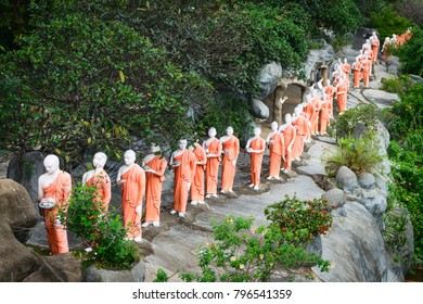Statues of monks on a rock in Golden cave temple in Dambulla, Sri Lanka