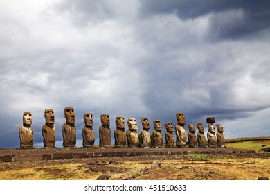 Statues on Easter Island under a stormy sky