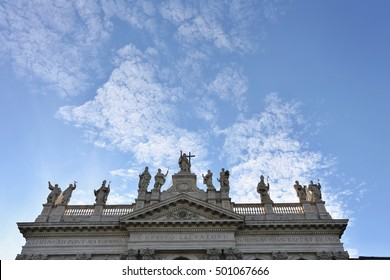 Statues on top of the facade of Archbasilica of St. John Lateran in Rome.
