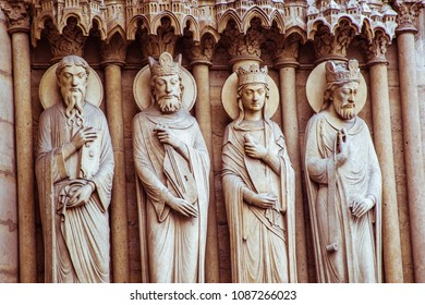 Statues of Saints, Kings and Bishops lining the entrance to the Notre Dame Cathedral in Paris, France.