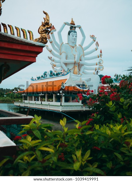 Statues of sitting Shiva in a temple complex on the water. Wat Plai Laem, Buddhist temple in Ko Samui, Thailand