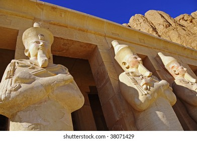 Statues stand guard outside of Queen Hatshepsut Temple.  This queen, the female Pharaoh, ruled over her temple in Luxor, Egypt on the west bank of the Nile