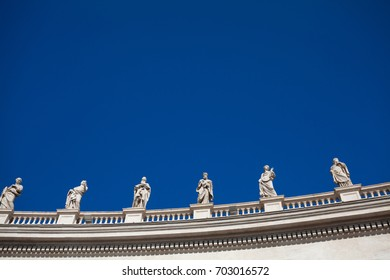 Statues standing on the roof of St. Peter's Basilica in  Vatican. Italy