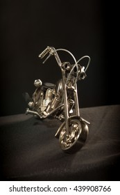 Statuette of a metal, a small model of the motorcycle