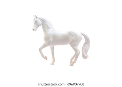 Statuette of white horse isolated on white.