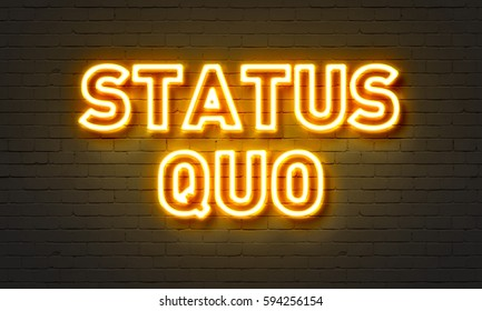 Status quo neon sign on brick wall background