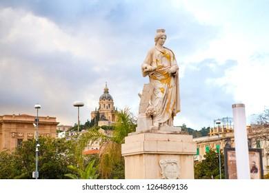 """""""Statuta Messina Riconoscente della Concessione del Porto Franco"""" - The Statue of Messina who recognized the concession of the Free Port, with church on the background. Sicily, Messina, Italy."""