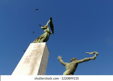 Staue of Liberty and the statue of the Torchbearer on Gellert hill in Budapest Hungary.