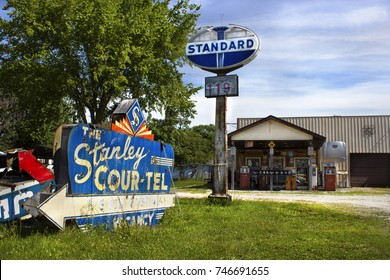 Staunton, Illinois, United States - circa June 2016 Henry's Rabbit Ranch on Route 66 in Staunton, Illinois. Outside Shows old, vintage Standard gas station sign, and gasoline pumps.
