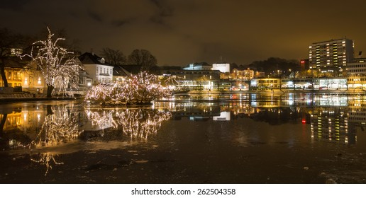 Stavanger city lake Breiavatnet with the Stavanger cityscape in the background at night