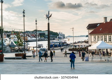 Stavanger, Norway - 07/13/2017: the main square in the center of Stavanger with locals and tourists wandering around on a sunny summer day