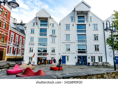 Stavanger, Norway - 25 July 2017: Sightseeing city shopping  center, White, Colorful house. Gifts shop. Nearby harbor, port Stavanger, Norway