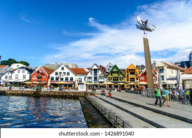Stavanger, Norway - 25 July 2017:  Sightseeing city shopping  center, restaurants, pubs, colorful houses, lot of tourists walking. Harbor, port, Marina in Stavanger, Norway