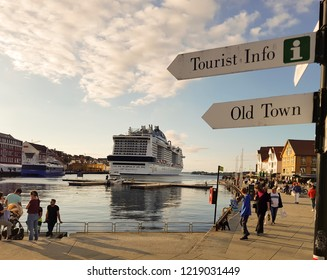 STAVANGER, NORWAY, AUG 21: Busy Stavanger City Center with a large cruise ship moored alongside. Road signs on the foreground on the August 21st, 2018