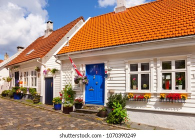 STAVANGER, NORWAY - AUGUST 01, 2017: Typical old white wooden homes in old part city. Stavanger is one of most famous cruise travel destinations in Europe.