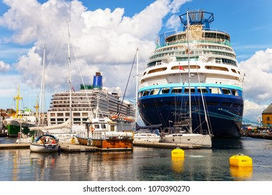 STAVANGER, NORWAY - AUGUST 01, 2017: People at the quay port with many restaurants and pubs in the city centre of Stavanger. Stavanger is one of most famous cruise travel destinations in Europe.