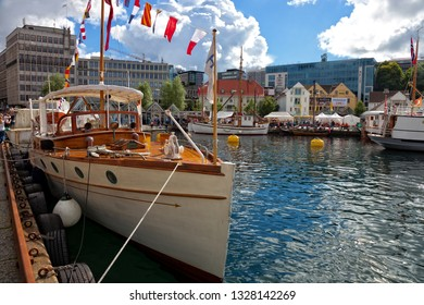 STAVANGER, NORWAY - AUGUST 04, 2017: People at the quay port with many restaurants and pubs in the city centre of Stavanger. Stavanger is one of most famous cruise travel destinations in Europe.