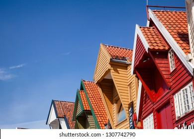 STAVANGER, NORWAY - AUGUST 14, 2018: Colorful facade of old wooden warehouse at Skagenkaien, a popular tourist attraction in Old Stavanger